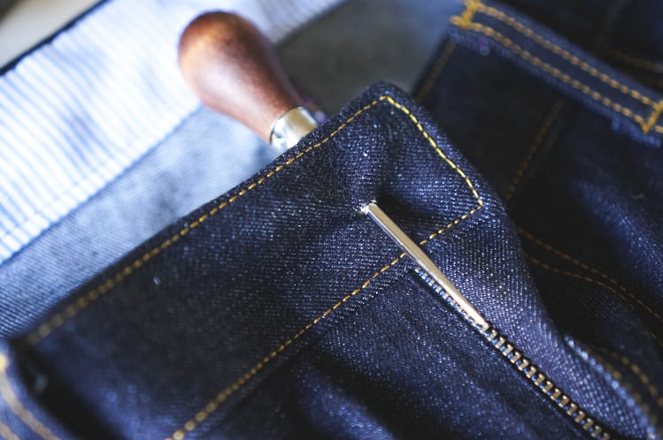 making hole in jeans with awl